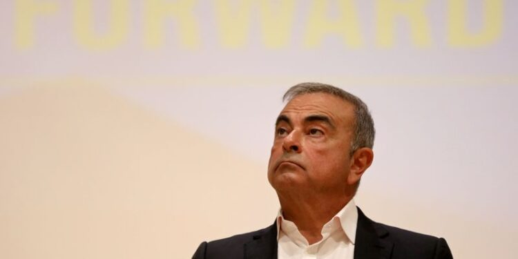 FILE PHOTO: Carlos Ghosn looks on during a news conference in Lebanon